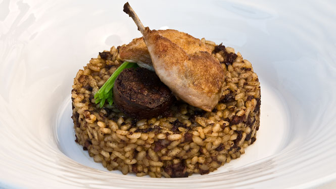 Rice with quail and Catalan blood sausage
